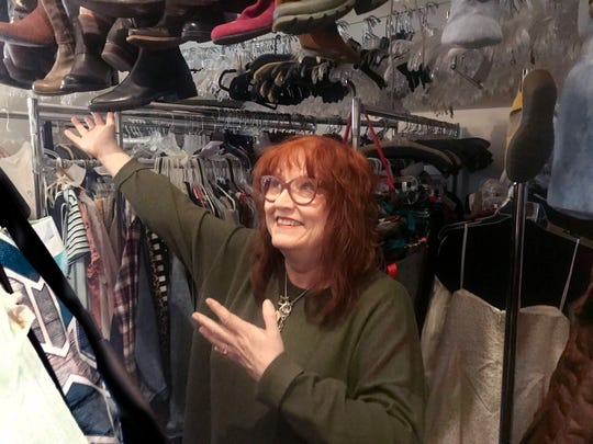 Designer Renaissance consignment shop owner Jodi Miller shows off her overstuffed storage room.