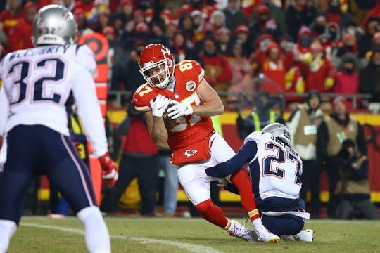 Kansas City Chiefs tight end Travis Kelce (87) catches the ball as New England Patriots defensive back J.C. Jackson (27) tackles during the second half of the AFC Championship game at Arrowhead Stadium on Jan. 20, 2019.