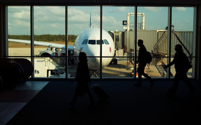 Passengers arriving from Dusseldorf, Germany, go to customs at Southwest Florida International Airport in Fort Myers in November 2018.