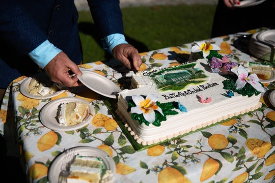 Cake is served at the Everglades Wonder Gardens to celebrate the commencement of construction of the Ernie & Sandie Schaub Butterfly and Orchid Pavilion in Bonita Springs on January 29, 2019.