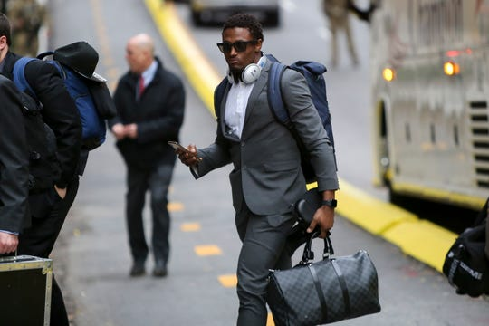 New England Patriots defensive back J.C. Jackson (27) arrives at the Hyatt Regency Atlanta on Sunday.