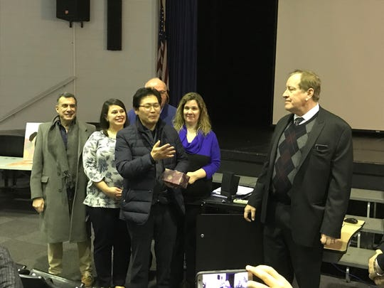Educators from South Korea gave a gift of appreciation to Palisades Park principal Frank Donohue for welcoming them into their school.