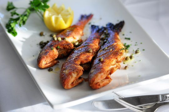 Fried Barbounia fish, photographed at Varka Estiatorio in Ramsey.