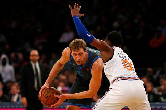 Jan 30, 2019; New York, NY, USA; Dallas Mavericks forward Dirk Nowitzki (41) looks to pass around New York Knicks guard Kadeem Allen (0) during the first half at Madison Square Garden.