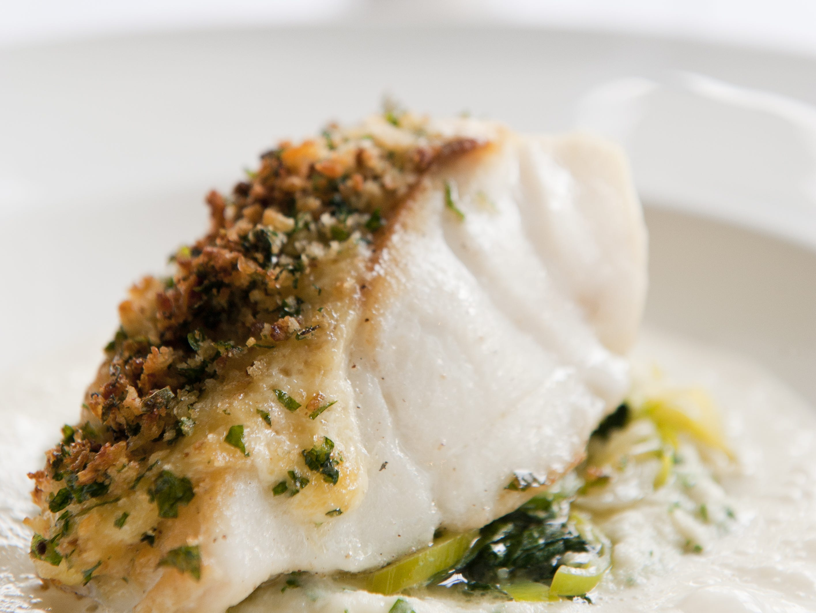 Cod is served with persillade, potato torta, leeks and parsley sauce at Tavro 13 in Swedesboro.