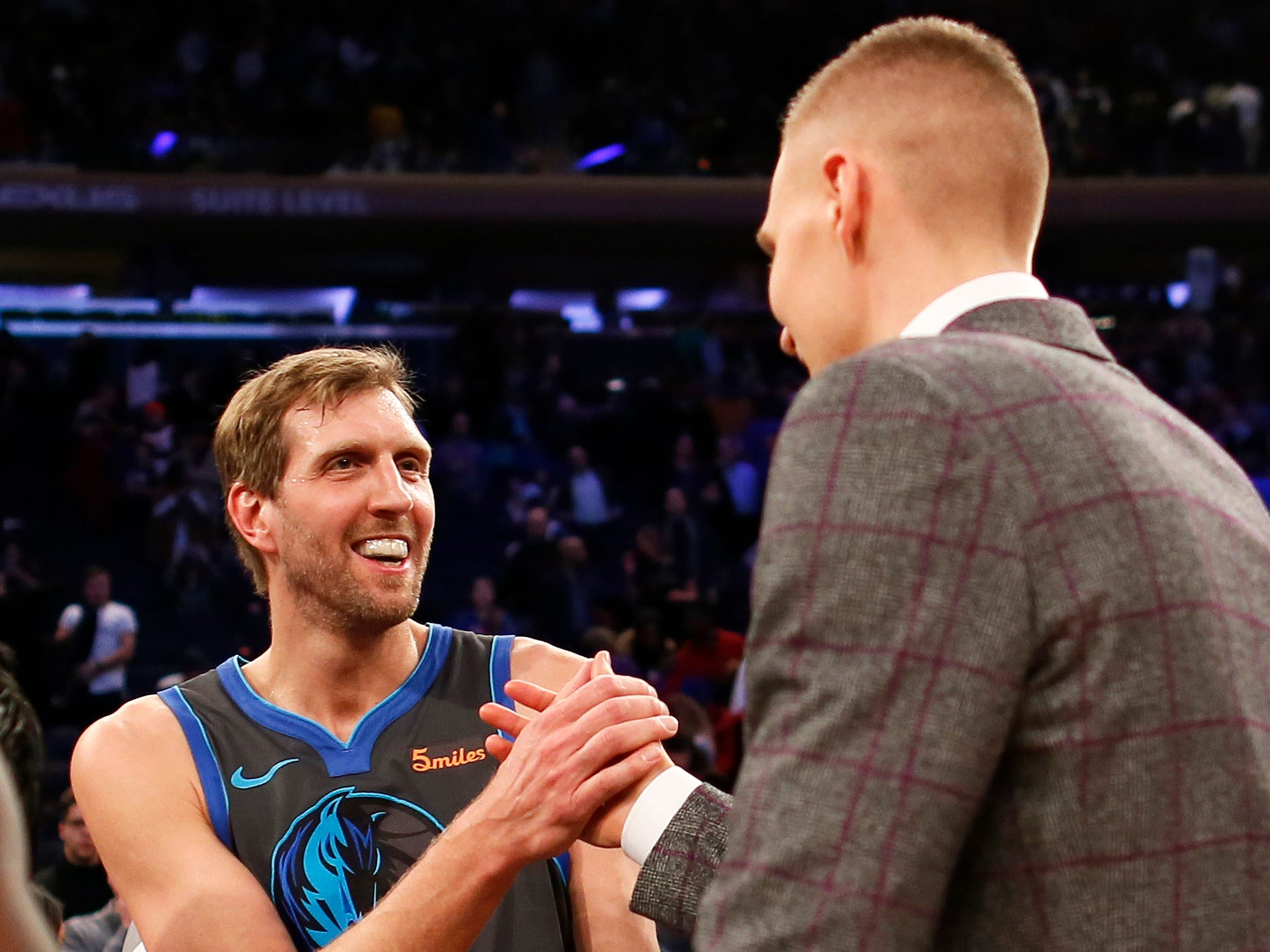 Jan 30, 2019; New York, NY, USA; Dallas Mavericks forward Dirk Nowitzki (41) shakes hands with New York Knicks forward Kristaps Porzingis (6) at Madison Square Garden.