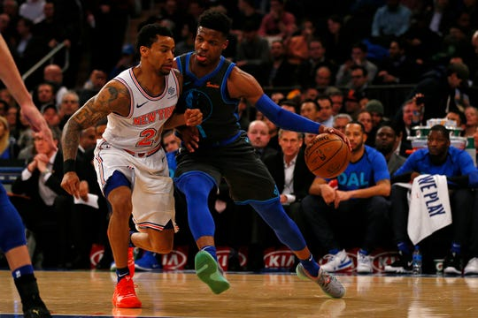 Jan 30, 2019; New York, NY, USA; Dallas Mavericks guard Dennis Smith Jr. (1) drives to the basket against New York Knicks guard Trey Burke (23) during the first half at Madison Square Garden.