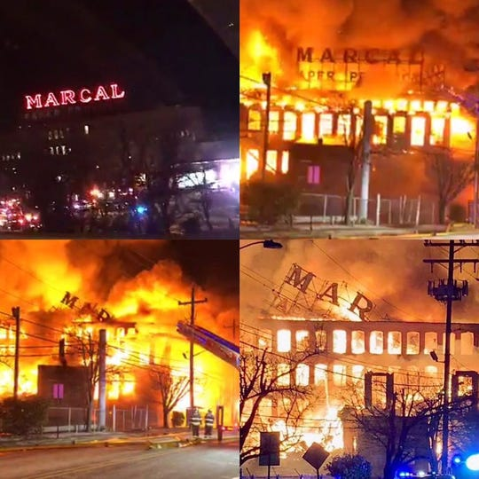 The Marcal Paper sign, an iconic since the 1940s, falls during fire on Wednesday, Jan. 30, 2019.