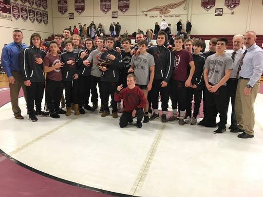 Emerson/Park Ridge poses with the NJIC wrestling championship trophy.