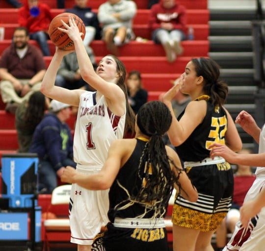 Sophomore Lady 'Cat Sierra Manos   (1) tossed in 14 points in a stellar reserve role.