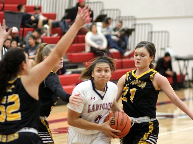 Freshman Lady 'Cat guard Harmanie Dominguez (3) maneuvered through Tigers' traffic for two of her game-high 23 points.