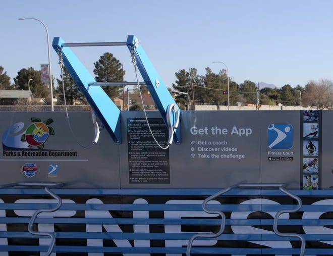 """Users of Las Cruces' new outdoor gym, dubbed the Las Cruces Fitness Court, may download an app, called """"Fitness Court,"""" to help with workouts."""