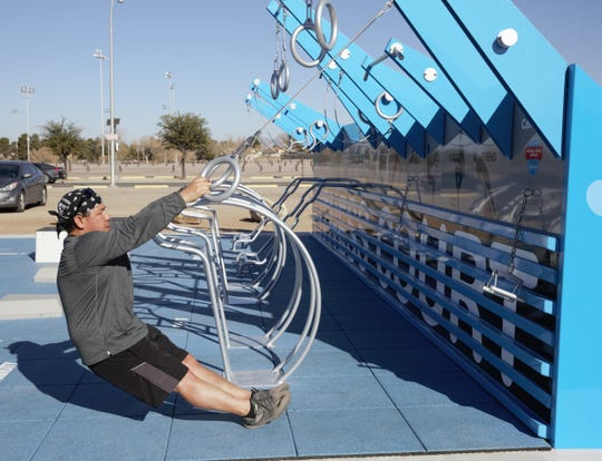 On Thursday, Jan. 31, 2019, Mario Reyes of Las Cruces tries out a new outdoor gym near the intersection of Walnut Street and Hadley Avenue. The facility opened a day earlier.