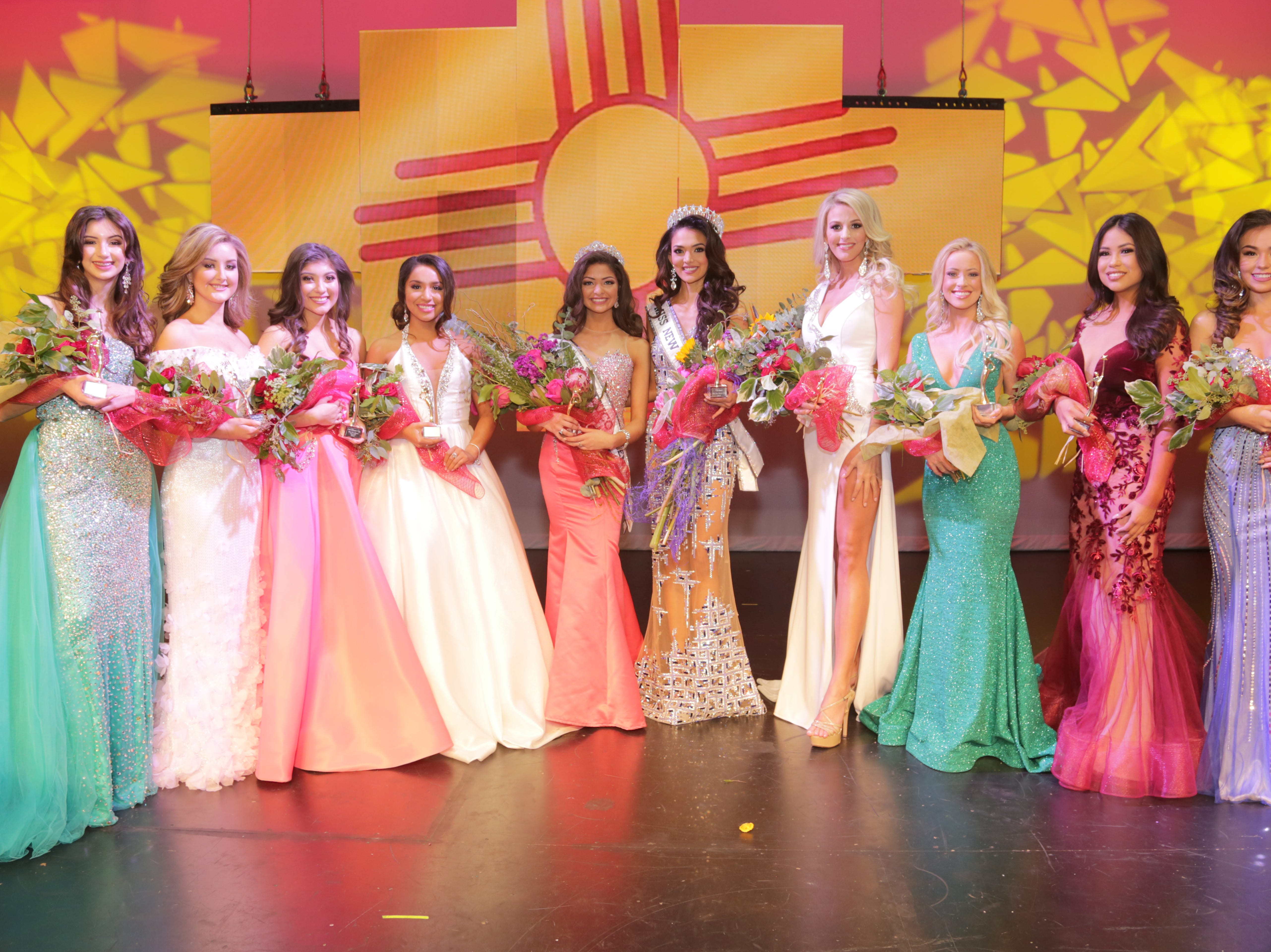 "Miss New Mexico Teen USA 2019 Angela Nanez and Miss New Mexico USA 2019 Alejandra ""Allie"" Gonzalez stand in the center with other Miss New Mexico USA 2019 contestants."