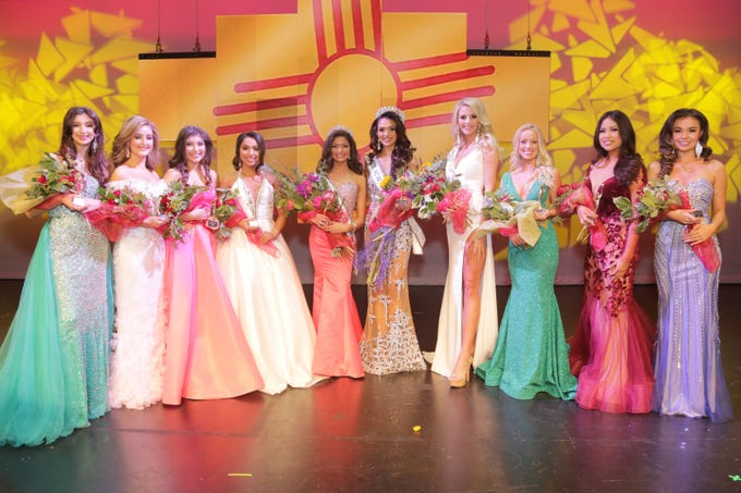 """Miss New Mexico Teen USA 2019 Angela Nanez and Miss New Mexico USA 2019 Alejandra """"Allie"""" Gonzalez stand in the center with other Miss New Mexico USA 2019 contestants."""