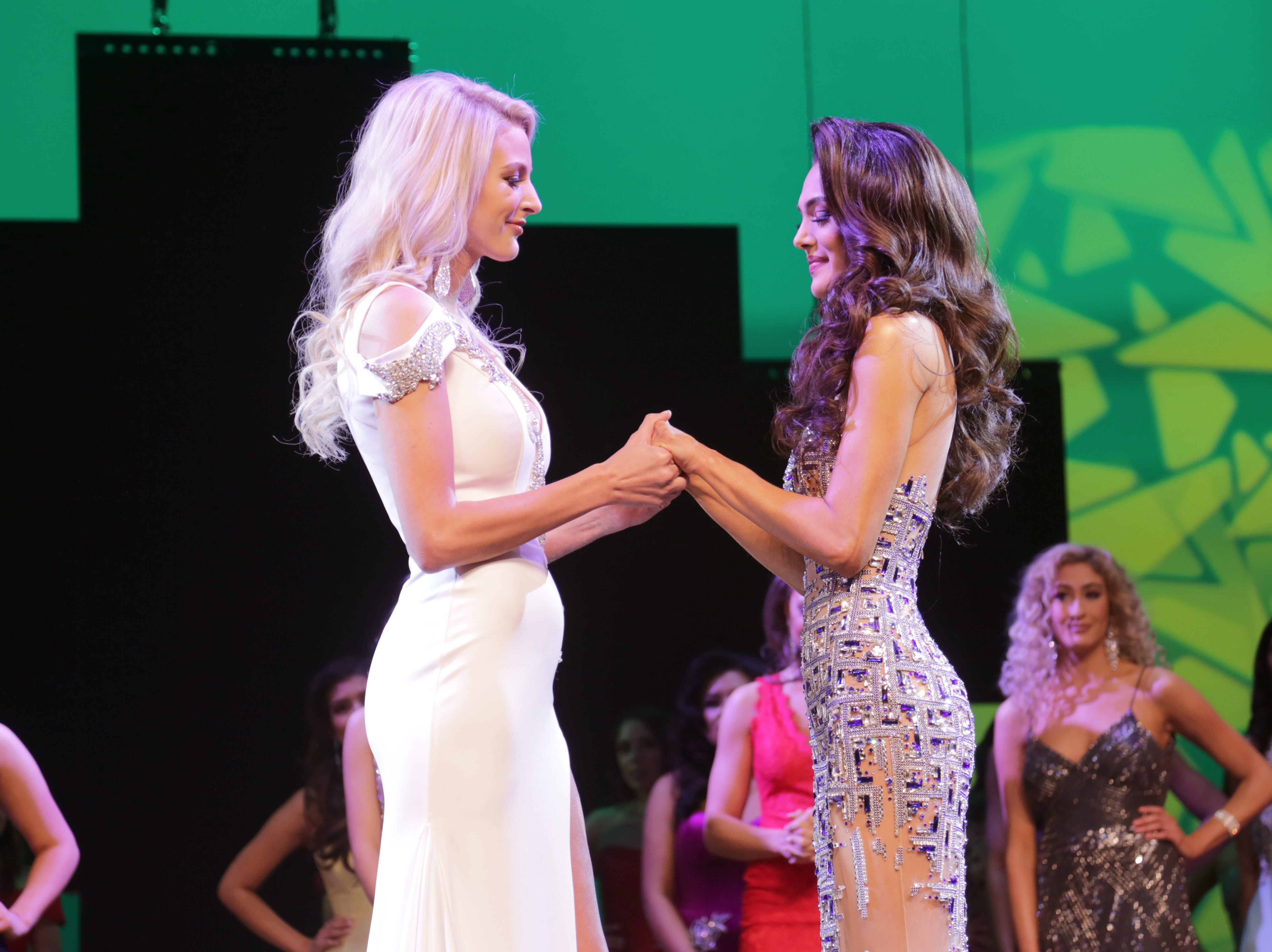"Miss New Mexico USA 2019 first runner up Tracie Taylor Turner, left, holds hands with Miss New Mexico USA 2019 Alejandra ""Allie"" Gonzalez before she was announced as the winner."