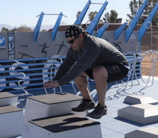 Las Crucen Mario Reyes jumps onto a stationary box on Thursday, Jan. 31, 2019 at the newly opened Las Cruces fitness court, southwest of the intersection of Walnut Street and Hadley Avenue.