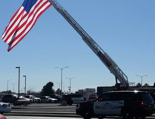 A motorcycle, bottom left, carries a flag-draped casket during procession for late Doña Ana County Sheriff's Department deputy John Paul Duffy on Thursday, Jan. 31, 2019. The procession made its way into the Mesilla Valley Community Church parking lot in preparation for Duffy's memorial service.
