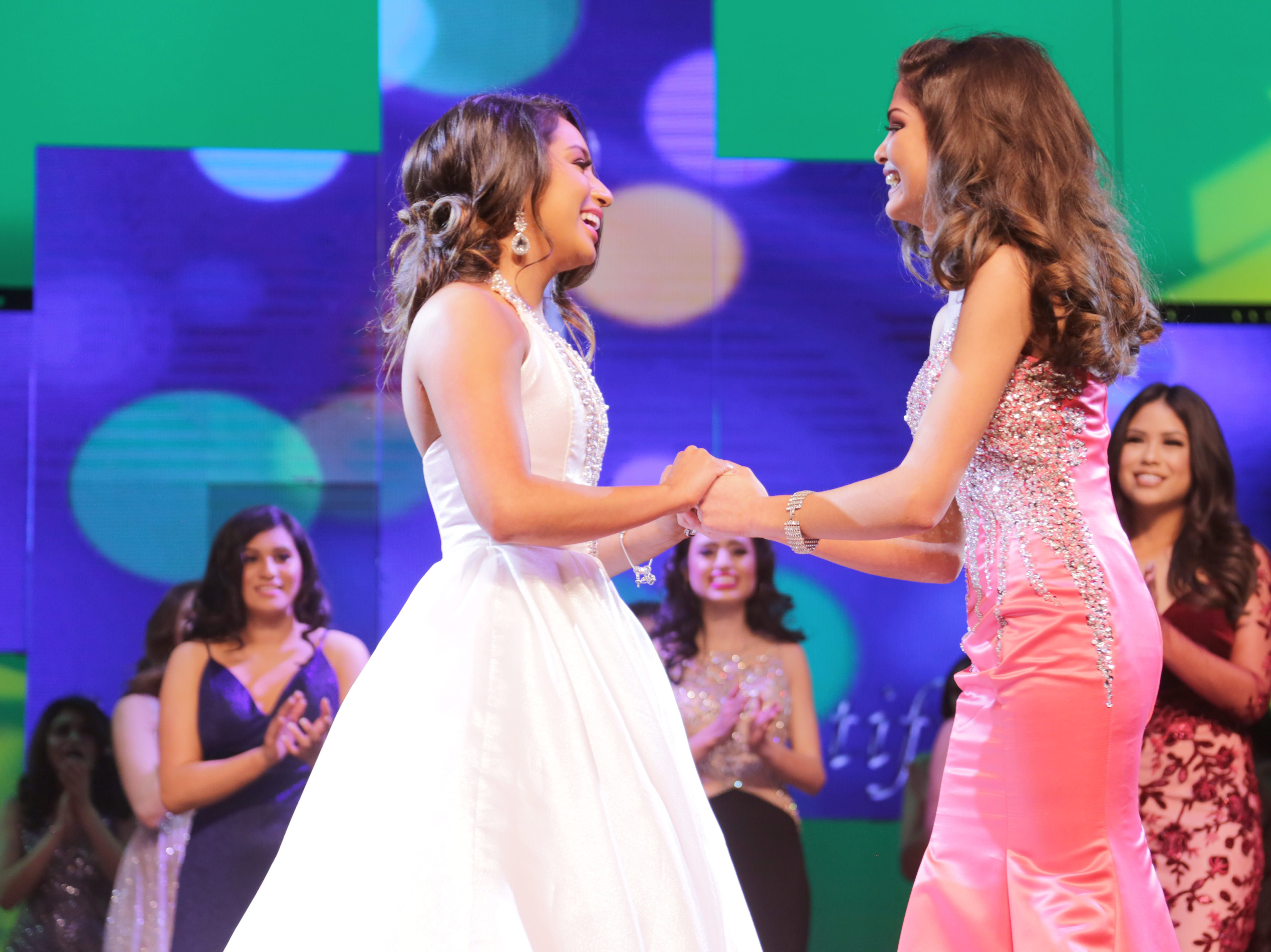 Miss New Mexico Teen USA 2019 first runner up Abigail Velez holds hands with Miss New Mexico Teen USA 2019 winner Angela Nanez, right, during the crowning announcement.