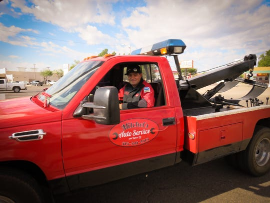 Mitchel Boomgaarn, who owns Mitchel's Auto Service and Repair, LLC, smiles from the cab of his tow truck. Boomgaarn was named the 2018 Star Client of the Small Business Development Center hosted by Western New Mexico University.