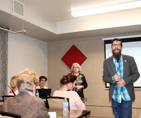 MainStreet Executive Director Cam Wilde  speaks at the draft Downtown Metropolitan Redevelopment Area Plan meeting Jan. 28 at the Sgt. Willie Estrada Civic Center.