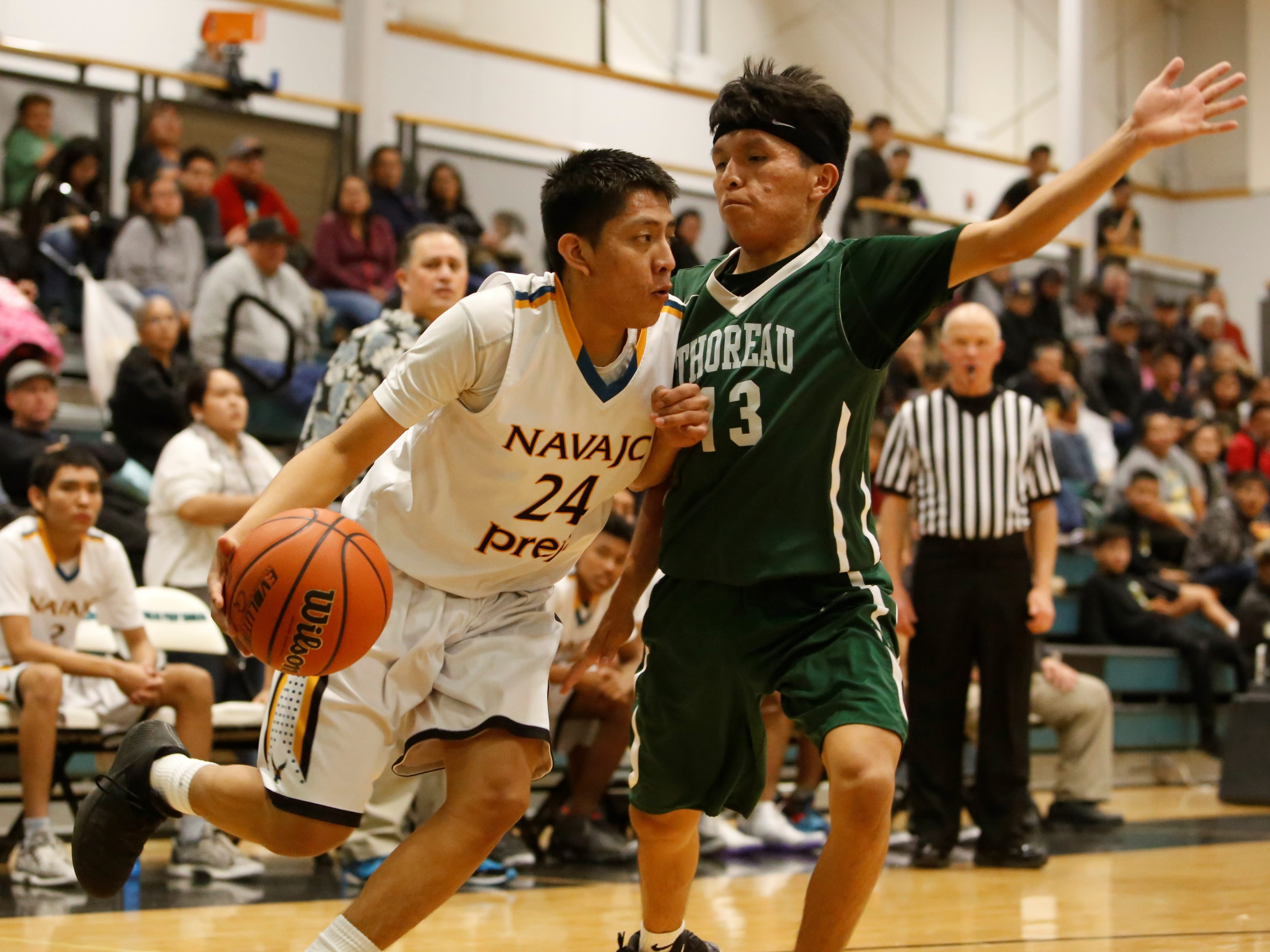 Navajo Prep's Treston Yazzie drives along the baseline against Thoreau's Orin Chacho during Wednesday's District 1-3A game at the Eagles Nest in Farmington.