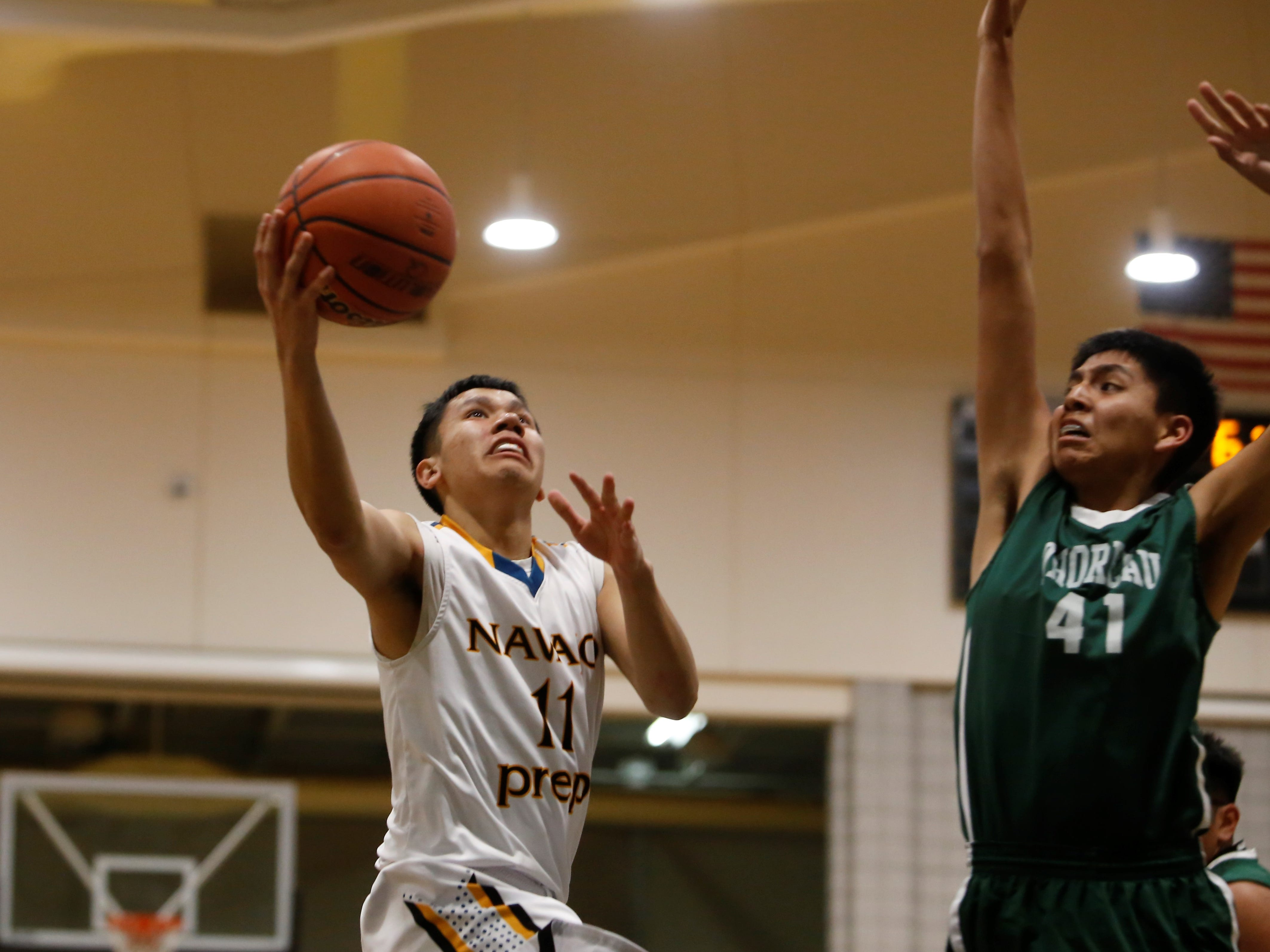 Navajo Prep's Thomas Montanez drives to the basket for a layup against Thoreau during Wednesday's District 1-3A game at the Eagles Nest in Farmington.