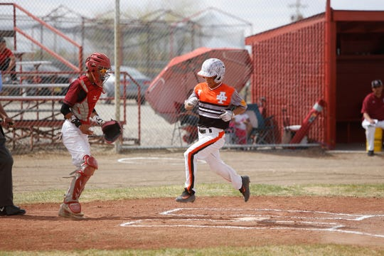 Aztec's Anthony Duran scores a run on April 6 during a game at Shiprock. The Tigers will open this season at the Valencia Tournament on Feb. 28.