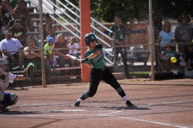 Farmington's Meghan Shim hits a single against Bloomfield on April 27 at the Ricketts Softball Complex in Farmington. The Lady Scorpions will open the season on March 5 at home against Kirtland Central.