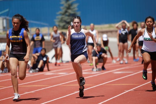 Piedra Vista's Savannah Skaggs bolts down the third lane during the first heat of the girls 100-meter dash at the Bloomfield Invitational on April 27 at Bobcat Stadium.