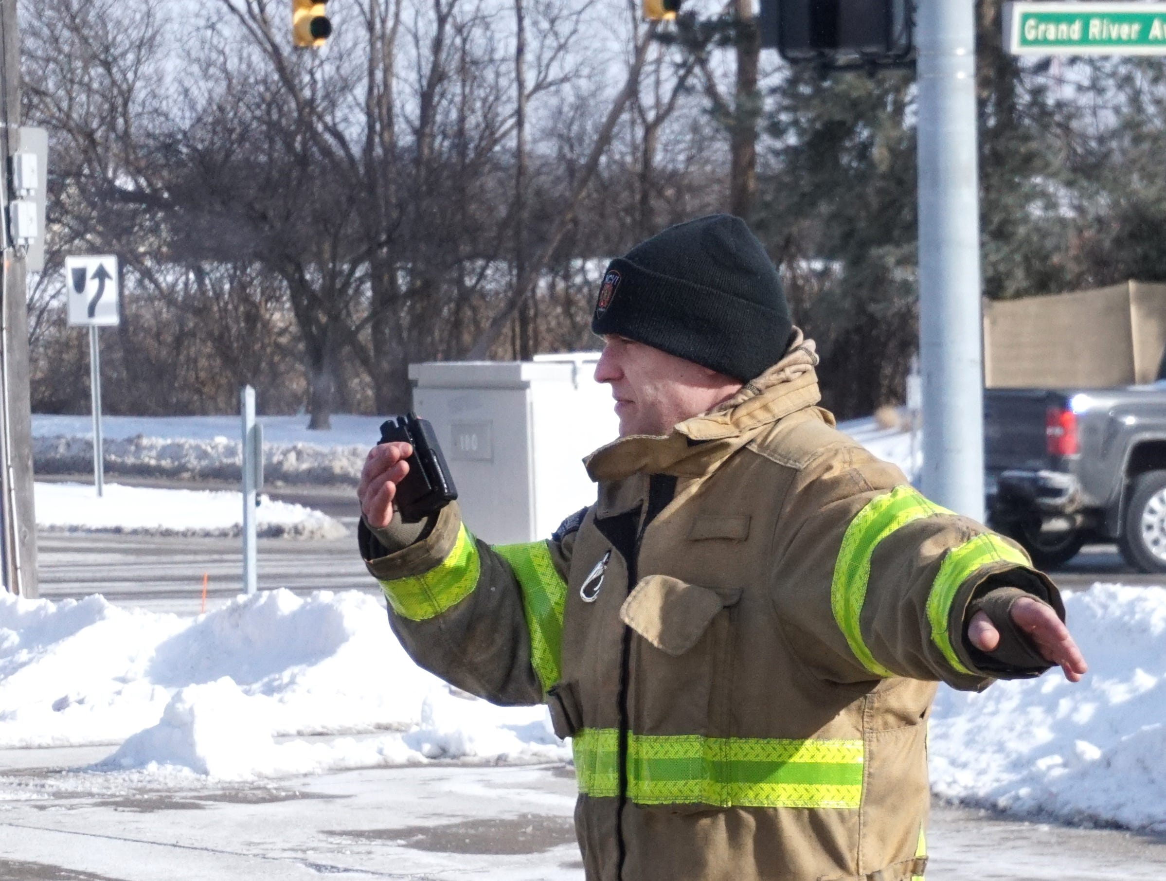 With at least momentarily bare hands, Novi firefighter David Pienik guides in a firetruck after an emergency call at Fire Station #1. Wind chill readings at the time of this photo were more than 20 degrees below zero and frostbite could occur when bare skin is exposed for not much more than five minutes at a time.