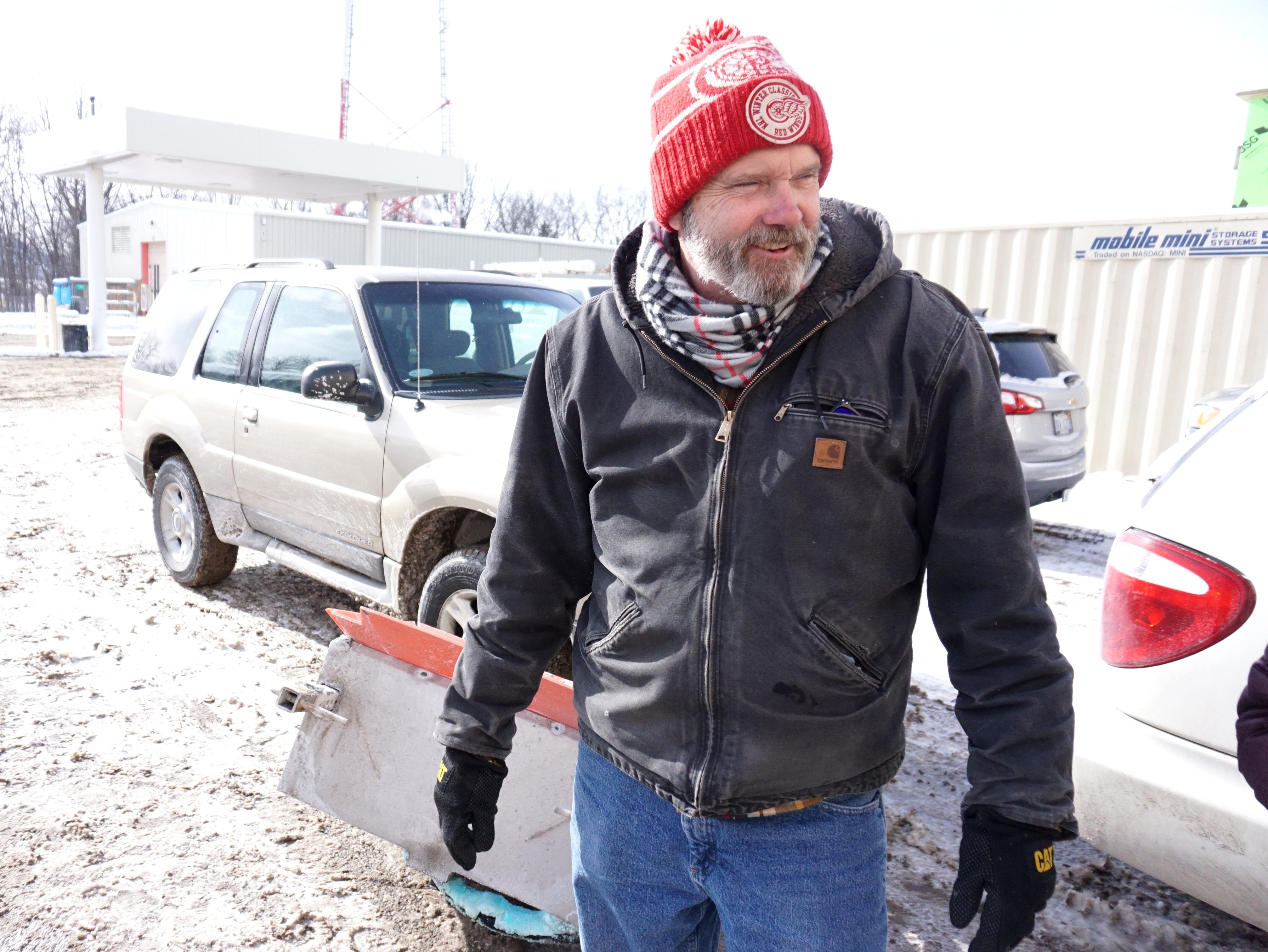 Novi housing inspector Gary Baumgardner prepares to take off from the city's DPW yard on Wednesday after inflating his car's tires which were low - due to the cold temperatures - and head back out to inspect heating and cooling units.