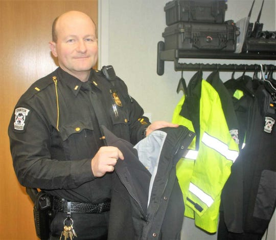 Canton Township Lieutenant Jim Harrison shows the layered outer wear the department's patrol officers wear.