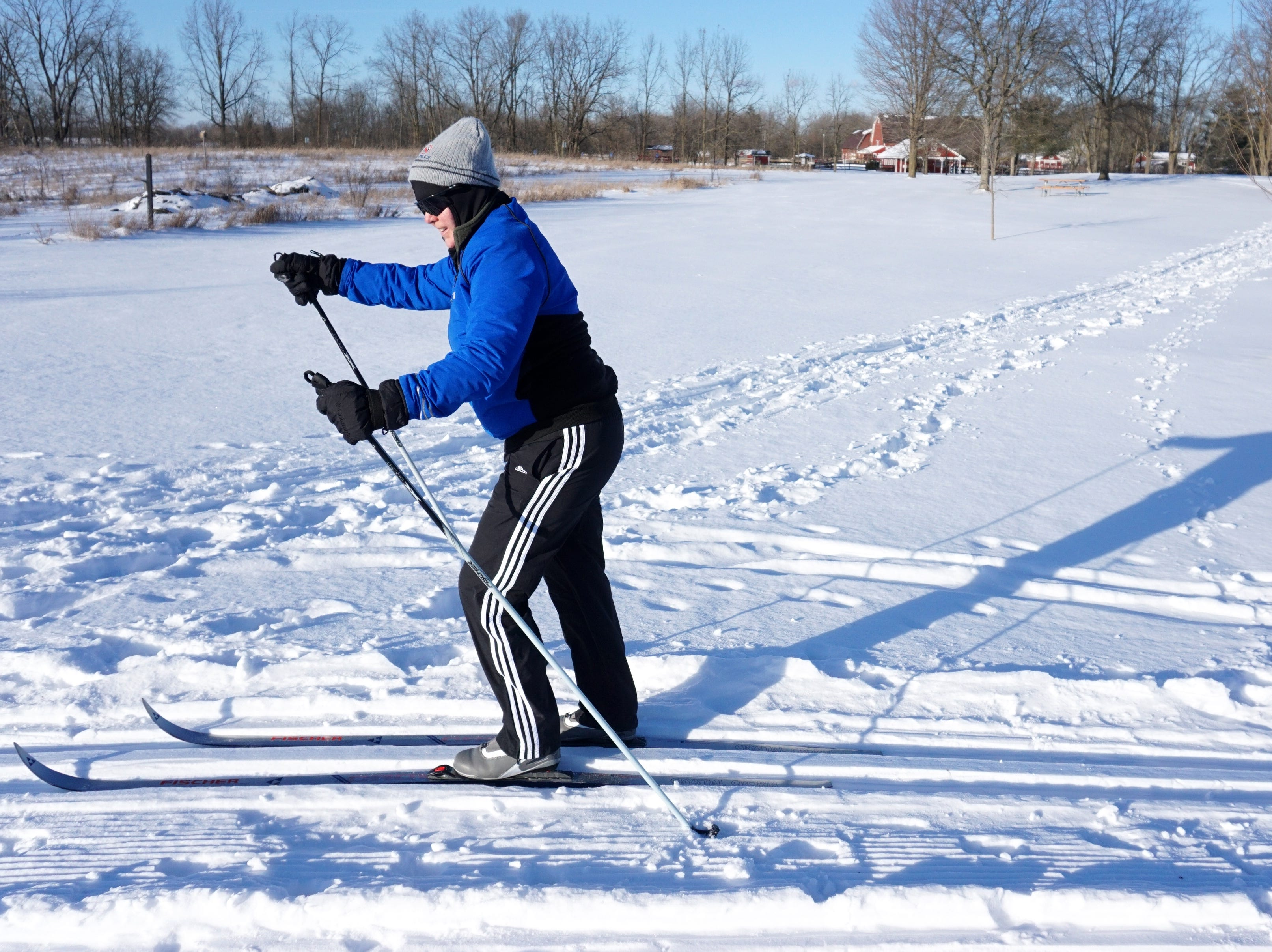 Sue Thompson, of Plymouth, takes to the trails of Northville's Maybury State Park on Jan. 31. Thompson said the skiing that day was much easier than recent days - when the wind made being outside so painful to any exposed skin. Maybury grooms its trails to benefit cross country skiiers, too, and on the weekends it keeps a warming fire going in its concession buidling off Eight Mile Road - for those hitting the trails.