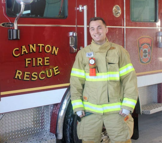 Canton paramedic Michael Elrod displays the cold-weather apparel he and his colleagues wear on colder-than-normal days.
