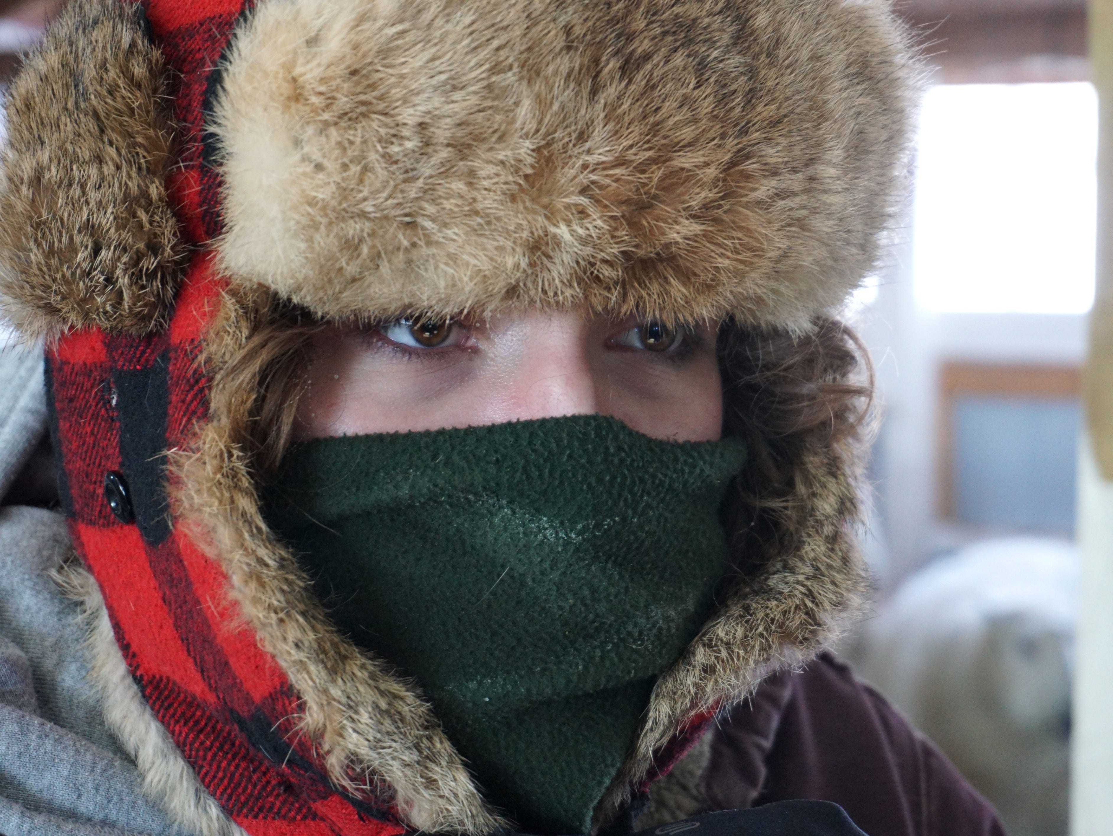 Tollgate Farms' livestock worker Sam Stokes bundles up as she prepares to head back outside on Wednesday afternoon.