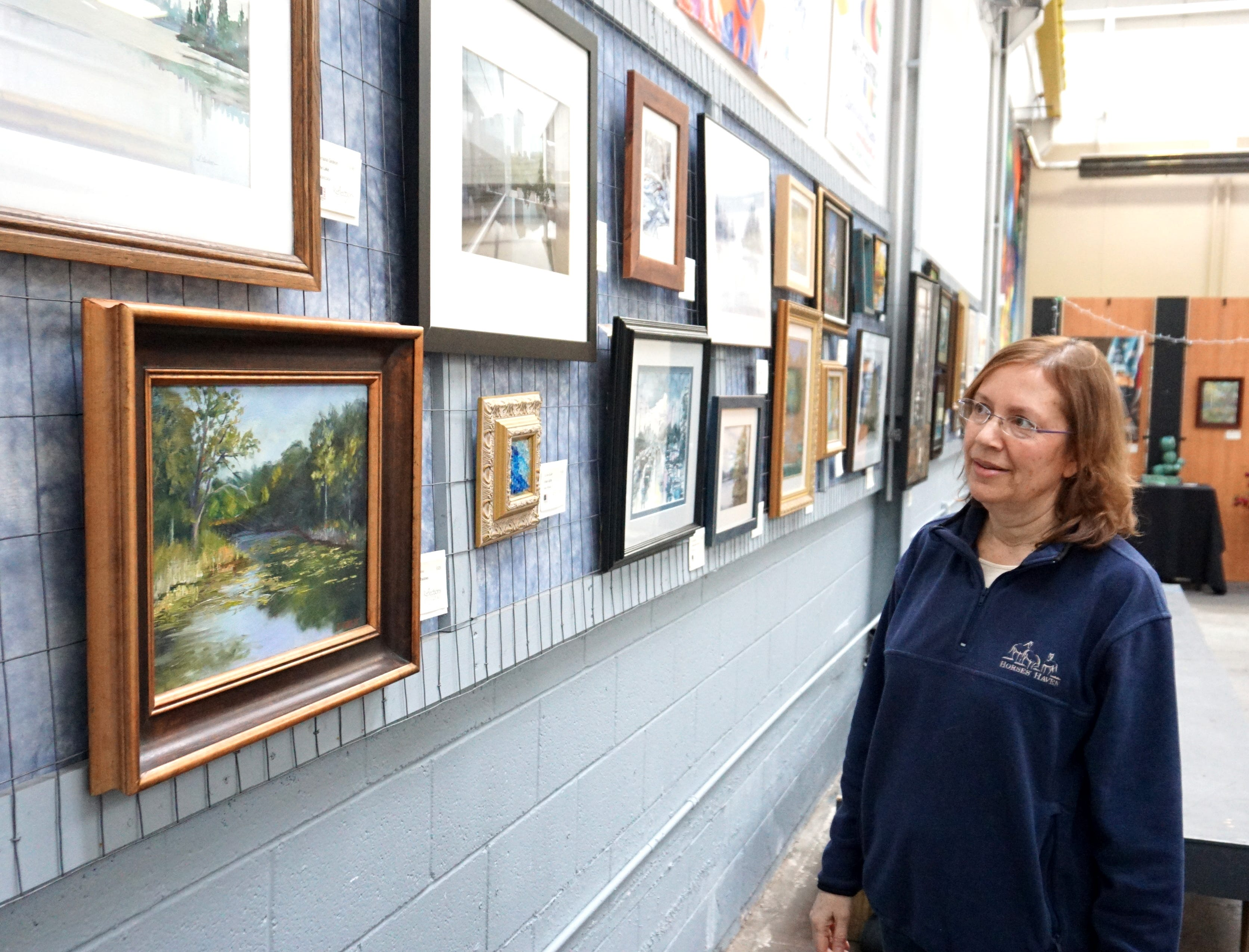 "Not everything fun taking place on Thursday was outside in the frigid temps. Suzanne Haskew Art Center employee Candace Brancik takes a look at some of the work being displayed at its most recent exhibit ""Reflections"". The show is to be displayed until Feb. 5 and many of the works are for sale. For more information go to shac@milfordvfaa.org or call 248.797.3060."