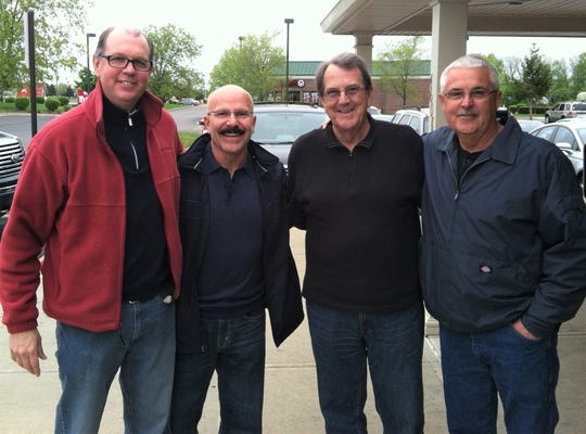 Brad Emons (from left) with former John Glenn football coaches Mike Henry, Lloyd Carr and Chuck Gordon.