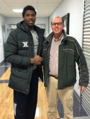 Brad Emons with former Livonia Stevenson High and Xavier University player Jalen Reynolds (right), now playing in Russia.