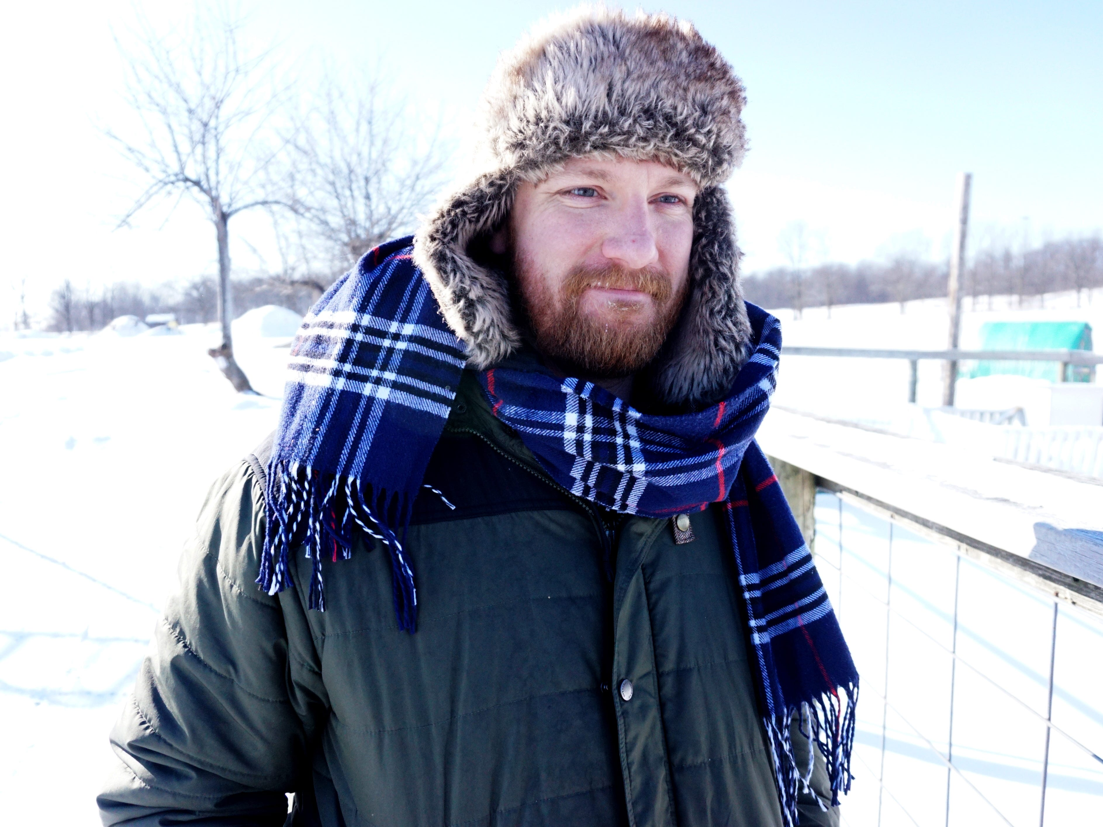 Novi's Tollgate Farm manager Mike Mathis walks away from the MSU educational facility's shelter for its sheep, goats and chickens on Jan. 30. Mathis and co-worker Sam Stokes were busy that frigid day keeping Tollgate's farm animals fed and watered and with shelter from the wind.