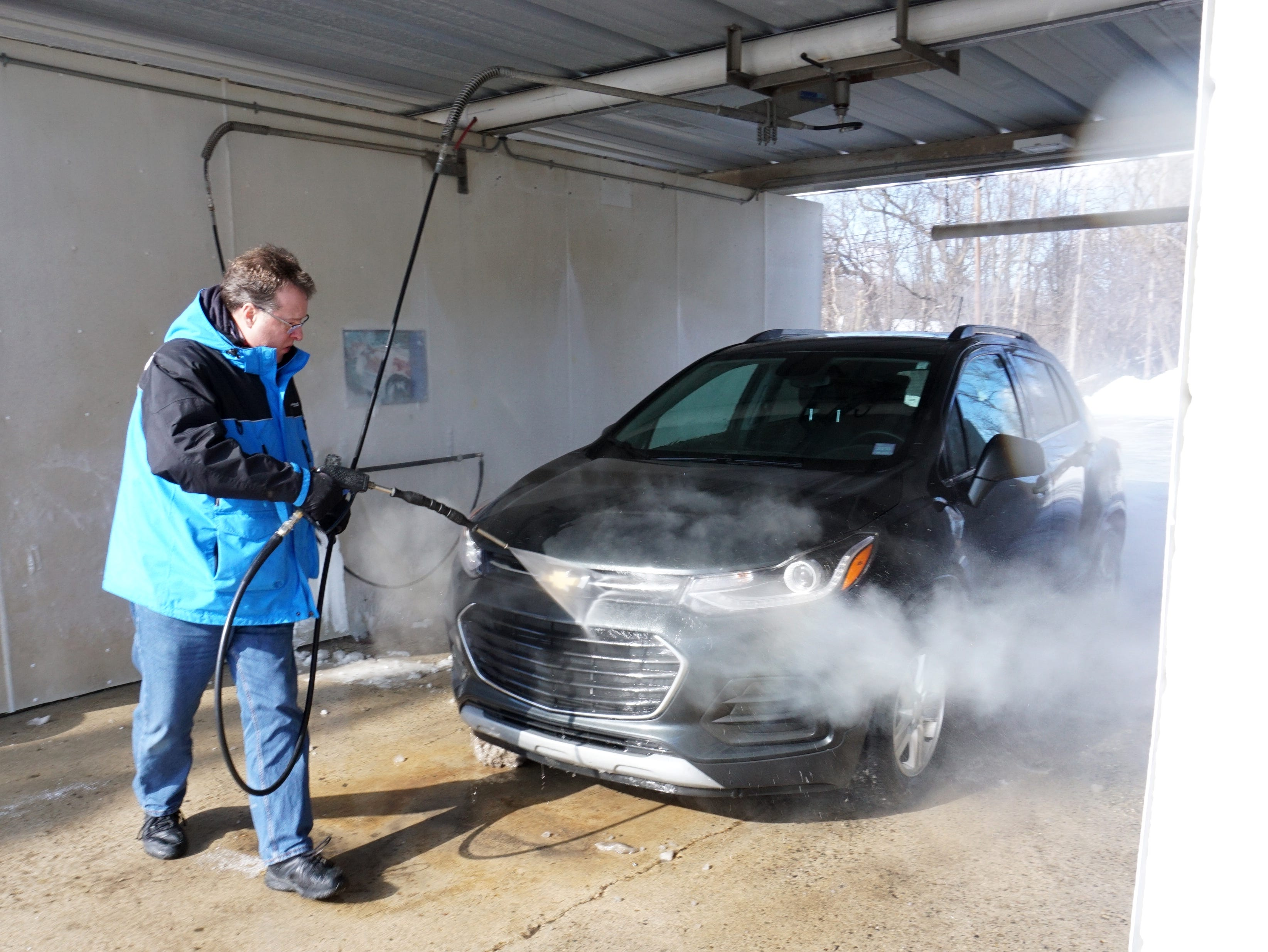 "When it was just a degree above zero New Hudson resident Rick Miller power-washes his Chevrolet at South Lyon's car wash near the South Lyon Hotel. Miller said: ""I might be an idiot to do this now, but you got to get the salt off your car."" Many others stopped by the wash to do the same, even though they left with cars sporting new icicles all over their cars."