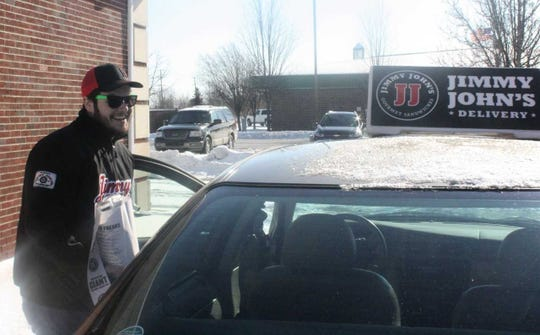 Jimmy John's delivery driver John Mullen prepares for another sub run in the frigid air.