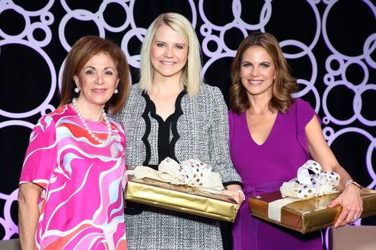 (l-r) Angie Gerber, President of the Barbara Sinatra Center, presents a gift to Elizabeth Smart and commentator Natalie Morales.