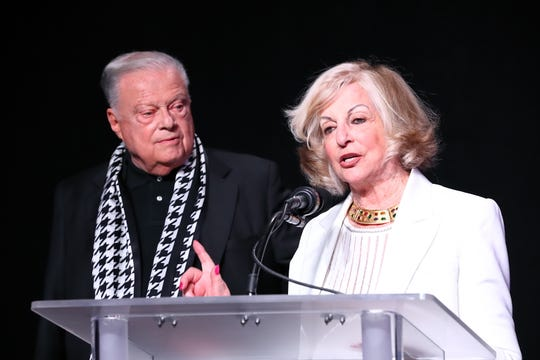 Co-Chairs Harold Matzner and Helene Galen at the microphone welcoming guests to the Champions Luncheon.