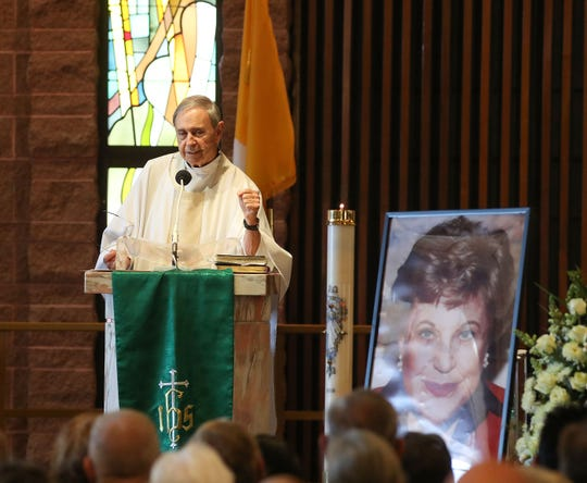 Monsignor Howard Lincoln speaks during a memorial service for Kaye Ballard at Sacred Heart Catholic Church in Palm Desert, January 30, 2019.
