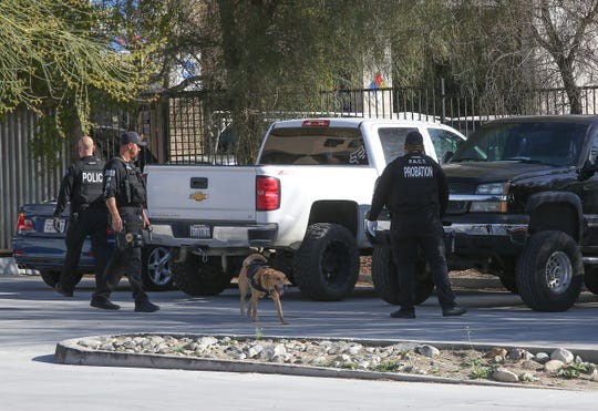 Officers search vehicles at an illegally operating dispensary in Thousand Palms, Calif., January 31, 2019.