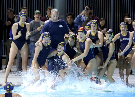 La Quinta's head coach Cal Lowell jumps into the pool with his team after their DEL championship win against Xavier Prep in Cathedral City on Wednesday, January 30, 2019.