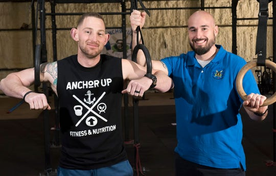 Ben Rera and Will Knehr stand for a photo Thursday at Anchor Up Fitness and Nutrition, their new fitness facility at 2464 U.S. 29 in Cantonment.
