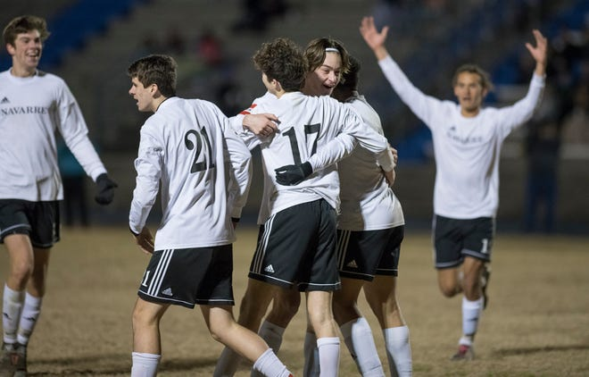 The Raiders celebrate Jack Patching (17)'s goal during the Navarre vs Washington soccer game at Booker T. Washington High School in Pensacola on Wednesday, January 30, 2019.  The Raiders defeated the Wildcats 5 -1.