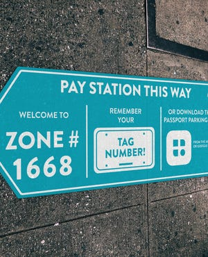 The DIB will place signs like this around downtown Pensacola letting people know how to pay for parking.